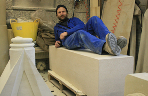 Matt Barton, Salisbury Cathedral stonemason, with the block of stone to be carved