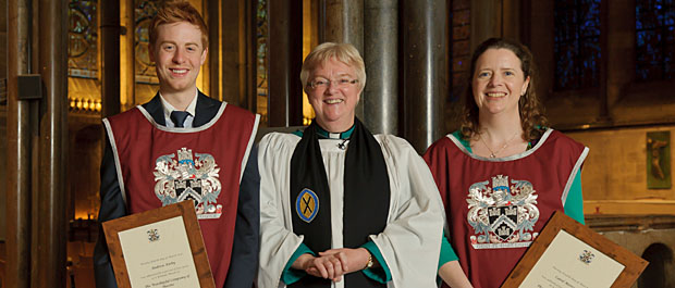 The Dean of Salisbury with stonemasons Andrew Kirby and Carol Merryman